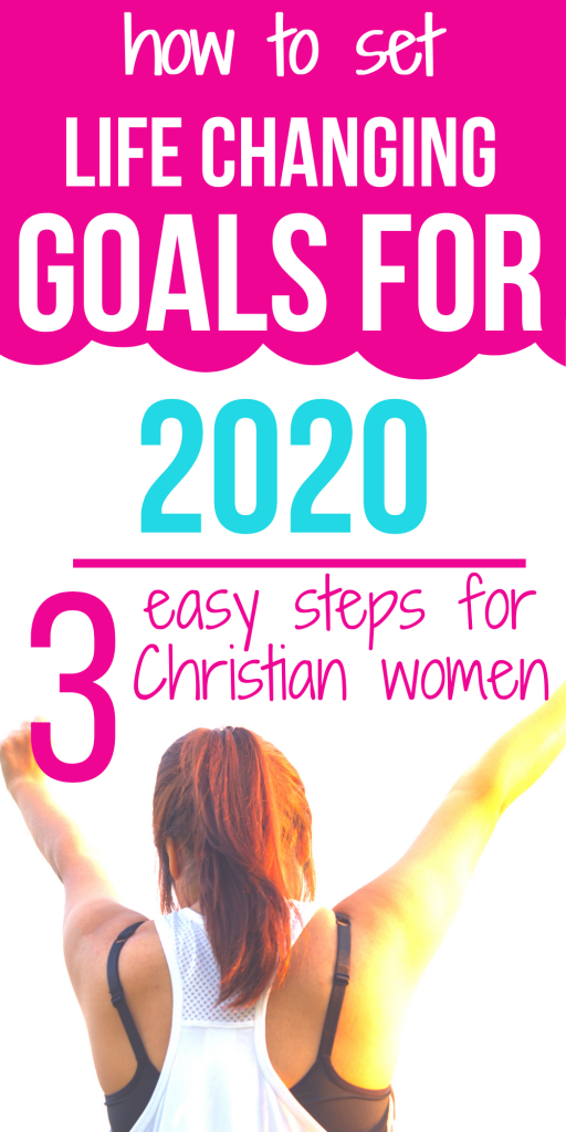 woman holding hands up in victory because she achieved her goals