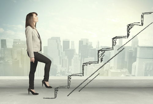 Business woman climbing corporate ladder - represents personal growth journey